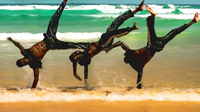 Breakdancers on a beach in Senegal