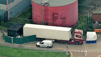 The bodies of 39 people are found in a lorry container on an industrial park in Essex.