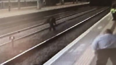 CCTV shows the 40-year-old throwing objects and shouting abuse at staff at a busy station.