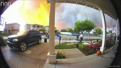 Doorbell footage shows residents fleeing their homes in California as a wildfire spreads nearby