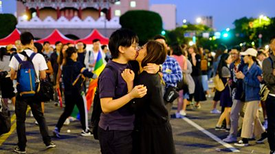 Lesbian couple celebrate Pride with kiss