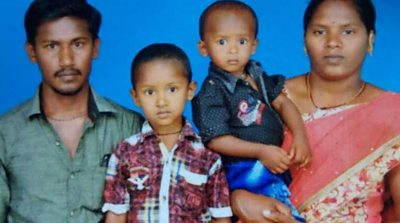 Sujith on his mother's arm with his brother and father