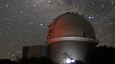 Super telescope against a starry sky