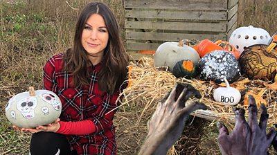 Kate Elgood with painted pumpkins