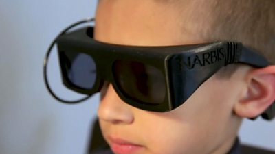 A child wears a pair of smart glasses
