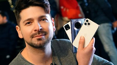 Chris Fox holding up smartphones