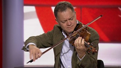 Stephen Morris playing his violin in the BBC News studio