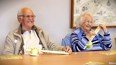 Bert and Enid Fitches playing their ukuleles