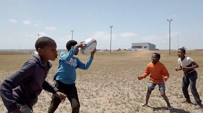 Kids playing rugby in Zwide, Port Elizabeth