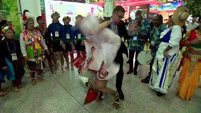 A dancer flips into the BBC's Aaron Heslehurst