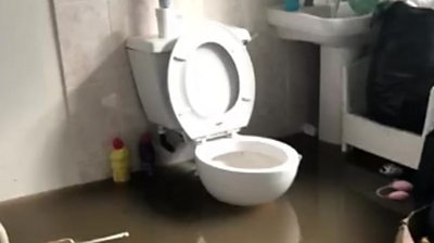 A flooded bathroom