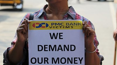 Woman protesting against PMC bank