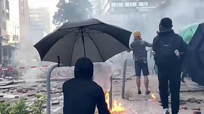 Protesters hit with tear gas at PolyU