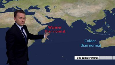 Matt Taylor with explanatory map of sea conditions
