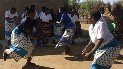 Malawian women dancig