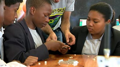 South African children learning to build satellites in school