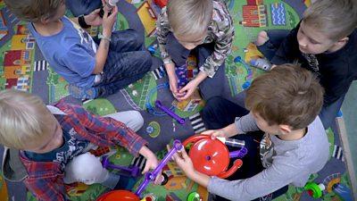 Estonian children play at kindergarten.