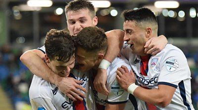 Coleraine players celebrate scoring