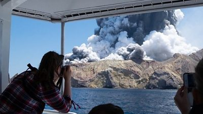 Volcano eruption seen from boat