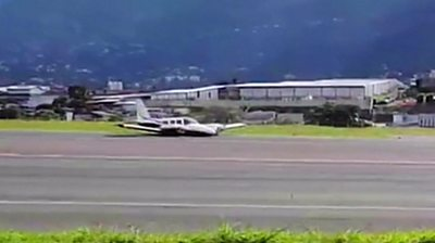 Plane on runway in Costa Rica