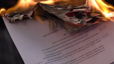 Protesters set fire to copies of the new citizenship bill