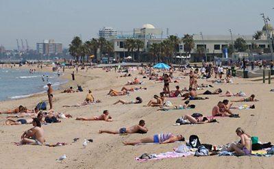 People on St Kilda beach, south of Melbourne, Australia