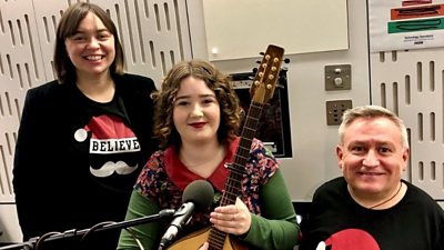 Kate Monoghan, Tilly Moses with her mandolin and Simon Minty