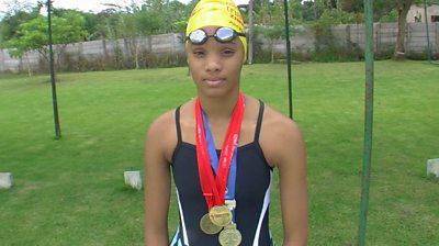 Donata Katai wearing gold medals