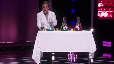 Camille Schrier conducted a chemistry demonstration on stage