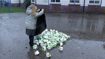 children emptying waste bags