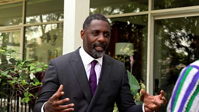 Idris Elba giving an interview to the BBC in Sierra Leone