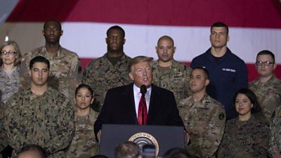 Donald Trump with US military personnel
