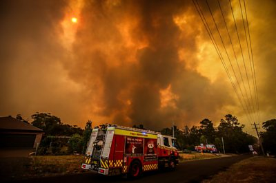 """Soaring temperatures and strong winds mean an """"awful day"""" for firefighters battling wildfires in Australia."""