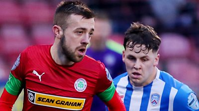 Cliftonville's Conor McMenamin with Coleraine's Ben Doherty