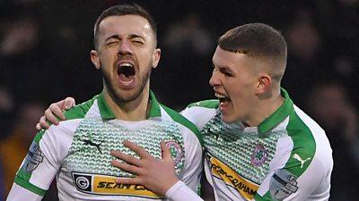 Conor McMenamin celebrates scoring Cliftonville's first goal.