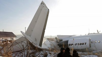 Rescuers at the site of an airplane crash near Almaty airport
