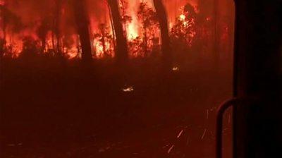 Fire truck overrun by bushfire flames