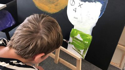 Markus painting at an easel