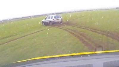 Driver pursued over fields