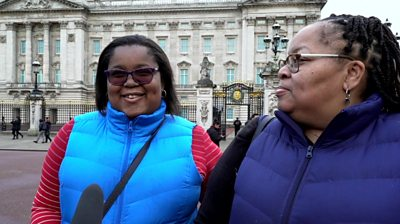 Two women outside Buckingham Palace