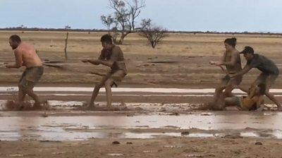 Australians play in mud