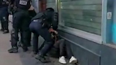 Footage shows Paris police officer punch protester