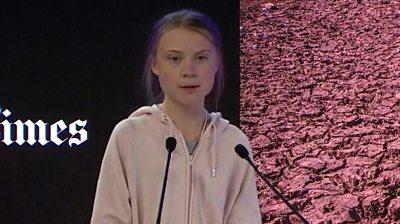 Greta Thunberg speaking at Davos on stage.
