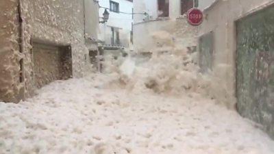 Marine foam brought ashore my Storm Gloria floods streets in Tossa De Mar in Spain.