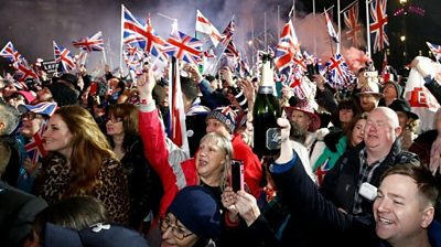 People waving Union Jack flags