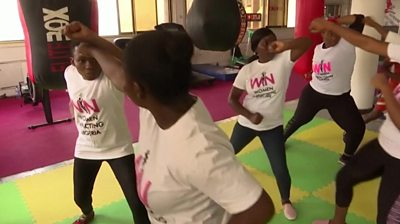 Women learning self-defence