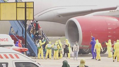 Indonesian evacuees from Wuhan being sprayed with disinfectant