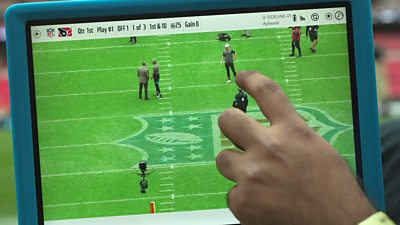 A tablet in use at an NFL game