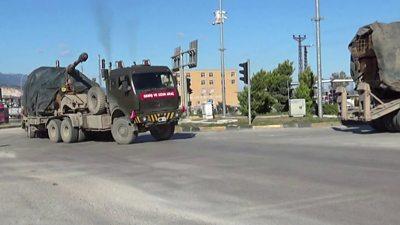 Turkish military vehicles pass through Kirikhan on the way to Syria