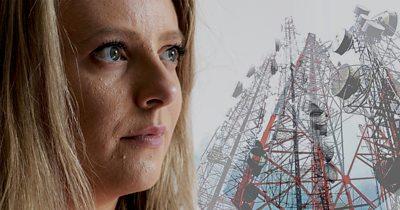 Emma looking at phone masts